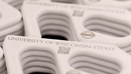 The Made at UW-Stout door pullers will help students open doors on campus without touching the handles during the pandemic.
